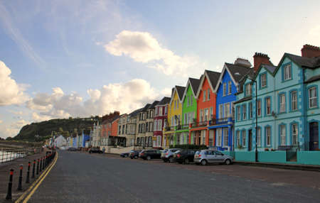 Small village on Antrim coast with coloured houses, Northern Ireland, United Kingdom Stock Photo