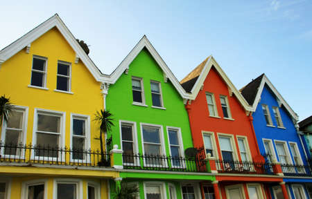 bright coloured wooden houses in a villege on Antrim coast in northern Ireland