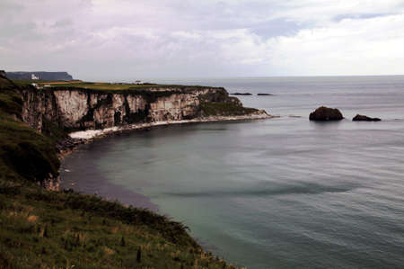 rainy irish landscape with white stone cliffs photo