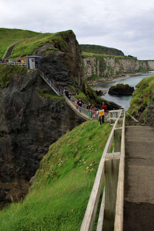 landscape with carrick-a-rede rope bridge, antrim coast, northern ireland photo