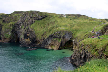 carrick-a-rede rope bridge and foothpath national park, antrim coast, northern ireland photo