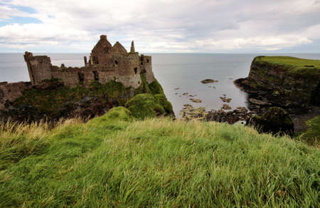 rainy: Dunluce Castle ruins and landscape, Northern ireland
