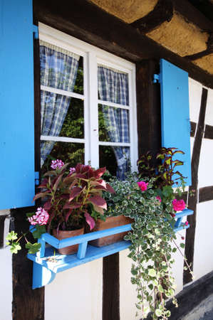 blue window in old country cottage