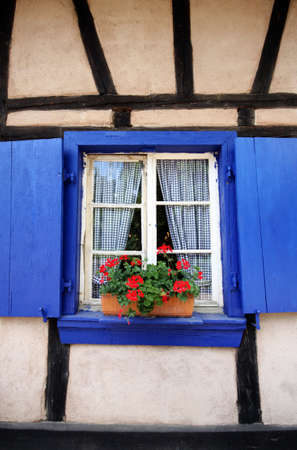 blue window in country old-style cottage photo