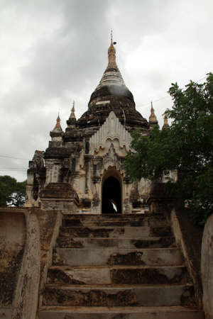 Bagan ancient buddhist temple called Ananda Pato with monsonic rain, Myanmar