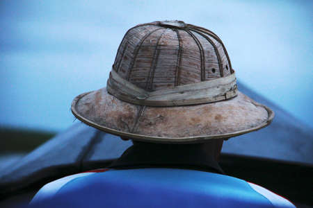myanmar man on a boat in the blue photo