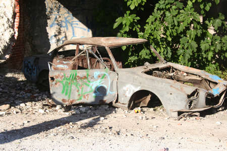 abandoned and damaged old car with a man s shadow Stock Photo - 19288878