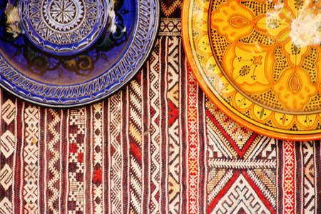 ancient atlantis: carpets and pottery in a market in Morocco