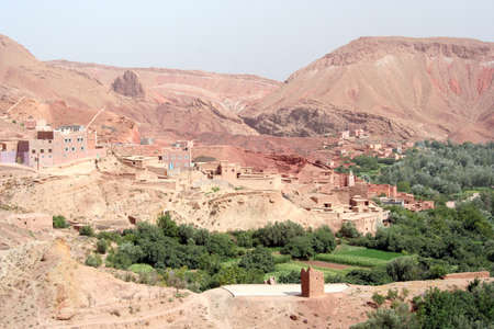 ancient atlantis: Moroccan Landscape with hills, kasbah and oasis Stock Photo