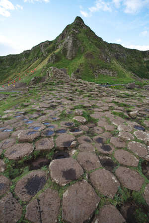 Giant Causeway stones and mountain photo