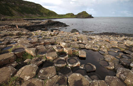 Giants Causeway stones and landscape, near Bushmills in Northern Ireland Stock Photo - 19596292