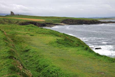 Private Castle on the cape, coast in Sligo county during rainy weather, Ireland Stock Photo