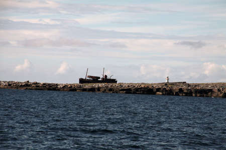 inisheer: view of Inisheer with an old abandoned ship, Aran islands