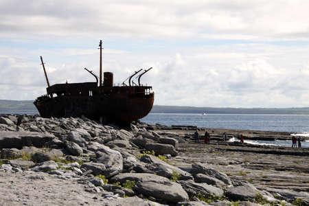 Old Shipwreck boat in backlight, Inisheer, Aran Islands, Galway county, Ireland Stock Photo