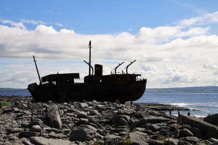 inisheer: Old Shipwreck boat in backlight, Inisheer, Aran Islands, Galway county, Ireland Stock Photo