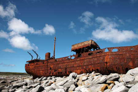 Red rust on old sank boat, shipwreck in Inisheer, Aran Islands, Galway county, Ireland photo