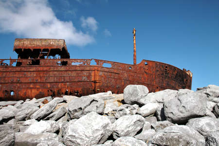 Red rust on old sank boat, shipwreck in Inisheer, Aran Islands, Galway county, Ireland Stock Photo