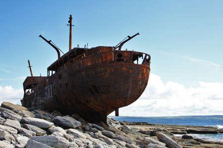 Old Shipwreck boat in Inisheer, Aran Islands, Galway county, Ireland photo