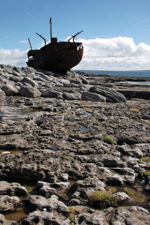 Old Shipwreck boat in backlight, Inisheer, Aran Islands, Galway county, Ireland Stock Photo