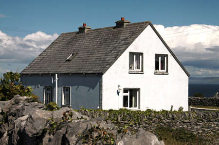 inisheer: white small house in its yard in Inisheer, Aran Island, Ireland Editorial