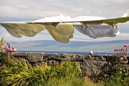 landscape with laundry hang to dry in Inisheer village in Aran islands, Ireland