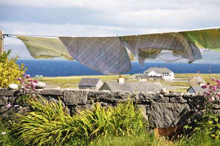 aran: landscape with laundry hang to dry in Inisheer village in Aran islands, Ireland