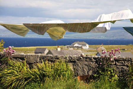inisheer: landscape with laundry hang to dry in Inisheer village in Aran islands, Ireland