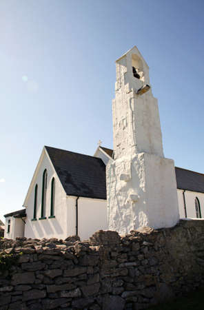 white small church and bell tower in Inisheer, Aran Island, Ireland