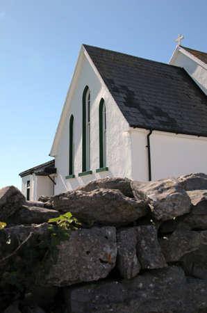 white small church facade in Inisheer, Aran Island, Ireland
