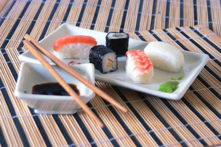 sause: sushi meal with soy sause and wood chopsticks Stock Photo