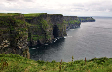 moher: Green grass and panoramic Cliffs of Moher landscape, Ireland