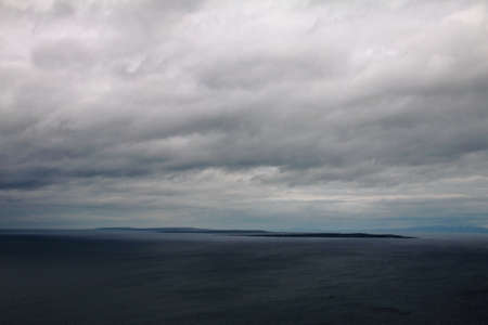 inisheer: Aran Islands viewed from the Cliffs of Moher, Ireland