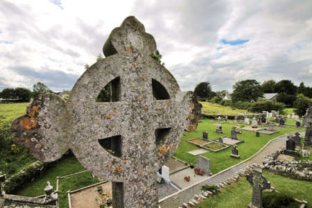 quin: Celtic cross and old cemetery at Quin Abbey ruins in Ireland