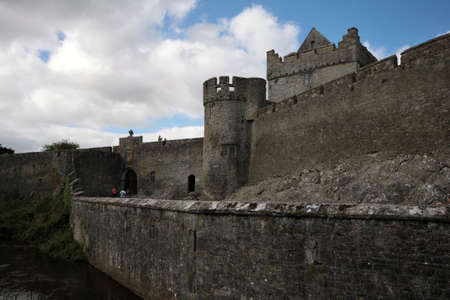 Cahir Castle with big walls and moat, Ireland