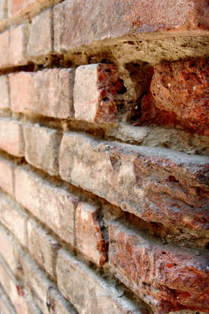 detail of wall made of red bricks, selective focus