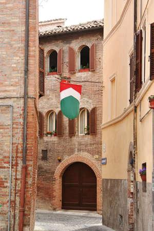 small road with italian flag, Marche, italy Stock Photo