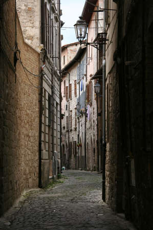Dark small street in Recanati downtown, Poet Leopardi hometown, Italy