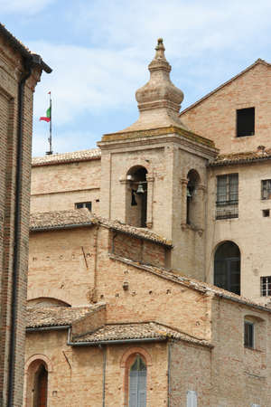 Bell tower and red bricks houses in Recanati downtown, Poet Leopardis hometown, Marche, Italy