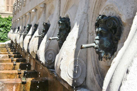 Historical fountain with bronze faces in Ancona, Marche, Italy Imagens