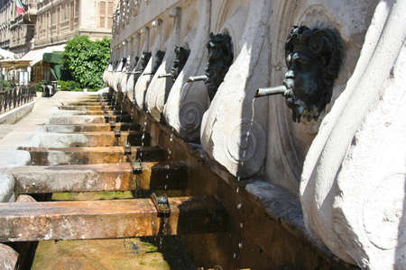 Historical fountain with bronze faces in Ancona, Marche, Italy Editorial