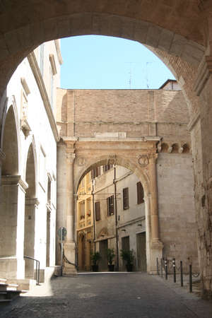 Road with roman arch and columns in Ancona city center