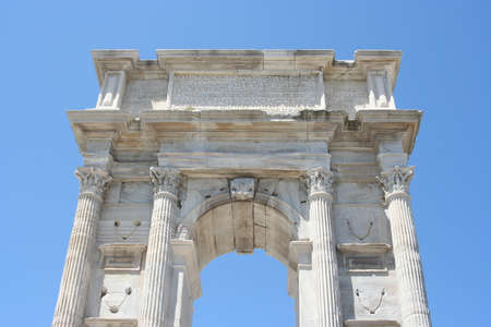 White marble roman arch in Ancona historical downtown Imagens