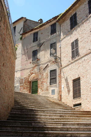 steps between small alley in historical village downtown in Marche, Italy