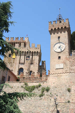 Clock tower of a castle in the country near Ancona, Italy