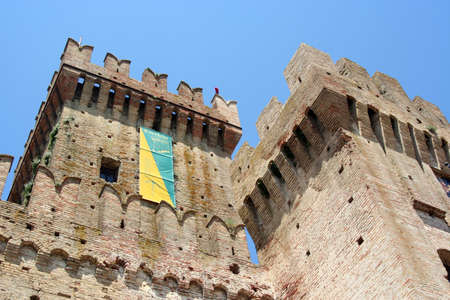 main big tower and smaller tower of a medieval castle in the country near Ancona, Italy
