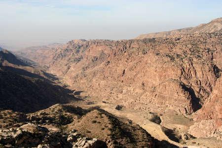 landscape of a misty canyon of red rocks in Dana Reserve, Jordan Imagens - 131785977
