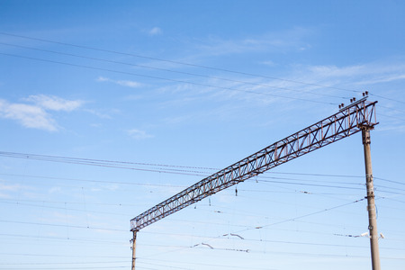 Power lines on a steel construction above a railway