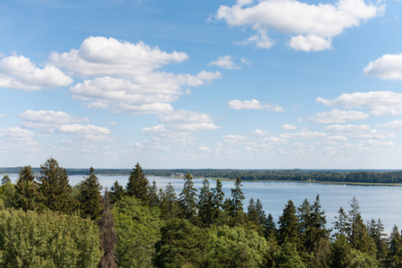 Overlooking the lake, forest and blue skies with white clouds