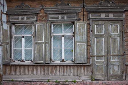 Old wooden and weathered town house facade Banco de Imagens
