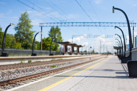 Blurred background of electric train station and railway tracks in the city center Banco de Imagens